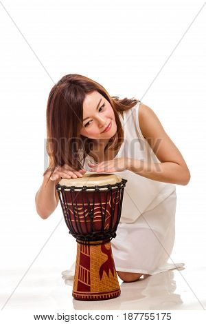 Asian Woman Playing Hand Drum