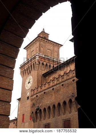 Clock tower, castle of Ferrara, Italy. Seen from the theater arcades.