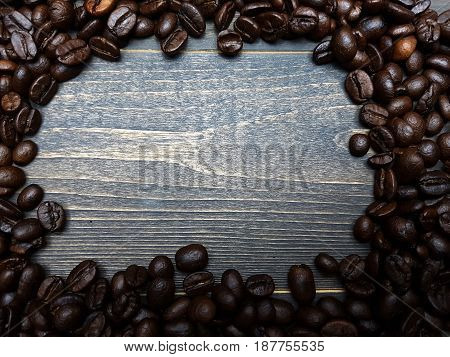 Coffee beans frame on dark wooden table