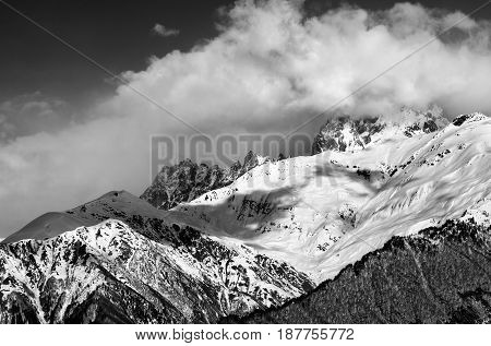 Black And White View On Snow Mountains In Clouds In Winter Sun Day