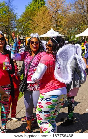 Nashville, TN, USA - 04/09/2015: African-American women taking part in the Sista Strut cancer walk at the Bicentennial Capitol Mall State Park in Nashville