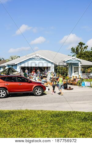 Port Charlotte, FL, USA - 03/14/2015: People at a typical weekend yard sale or Garage sale at a home in Florida
