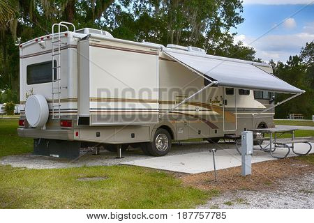 Arcadia, FL, USA: 05/25/2015: Front and side view of a 32ft class A motorhome with slideouts at Arcadia park in Florida