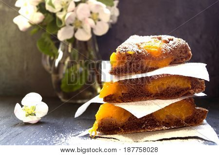Home-made Apricot Cake On A Dark Background.