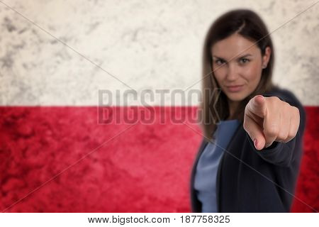 Beautiful Businesswoman Pointing Her Finger At You Polish Flag Background.