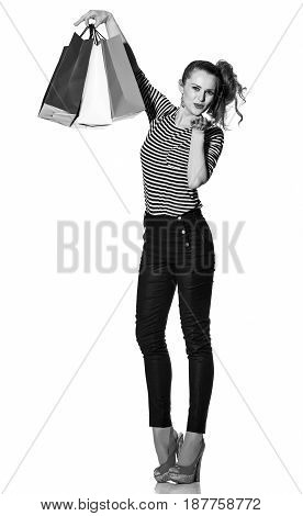 Trendy Woman With Shopping Bags On White Blowing Air Kiss