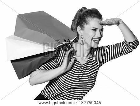 Stylish Woman With Shopping Bags On White Looking Into Distance