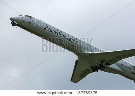 Sarasota, FL, USA - 01/06/2017: Canadair CL-600-2D24 commercial jet passenger plane of American Airlines departs Sarasota airport for CLT Charlotte NC