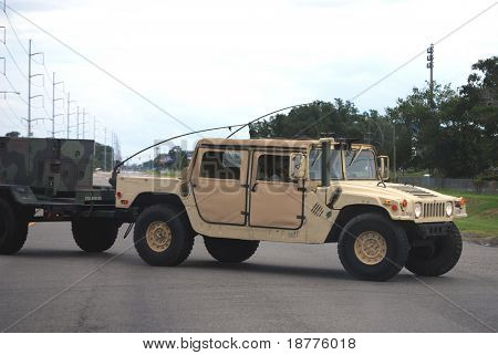 NEW ORLEANS - AUG 31: National Guard Humvee vehicle crosses a street with a generator to provide power during the onslaught of Hurricane Gustav on August 31, 2008 in New Orleans.