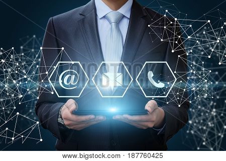 Businessman Showing Icons Contact Us.