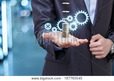 Businessman Earns Coins Through The Mechanism.