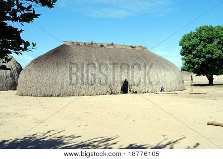 KAMAYURA VILLAGE, BRAZIL - MAY 18: The entire Kamayura tribe lives in one single village near Xingu river, in large houses covered with sape grass. Shot on May 18, 2008.