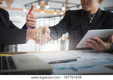 Business partnership meeting concept. Image businessmen handshake. Successful businessmen handshaking after good deal.