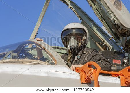 Military Pilot In The Cockpit Of A Jet Aircraft