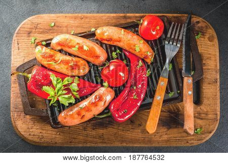 Barbecue. Home Hotdogs. Grilled Vegetables. Sausages, Tomatoes And Peppers On A Grilled Baking Sheet