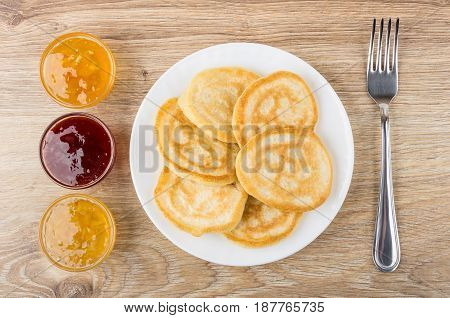 Pancakes In White Plate, Bowls With Jam And Fork
