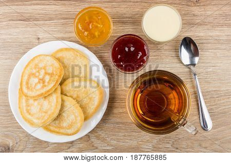 Plate With Pancakes, Different Jams, Transparent Cup Of Tea