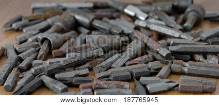 An assortment of screwdriver bits with shallow depth of field