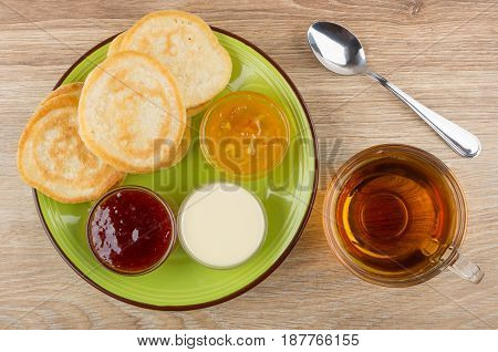 Green Plate With Pancakes And Different Jams, Cup Of Tea