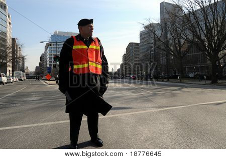 WASHINGTON - JAN 20: A crowd control officer stands at a closed intersection during the inauguration of U.S. President Barack Obama on January 20, 2009 in Washington.