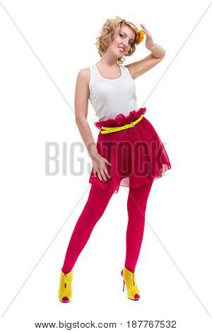 Full length shot of sexy woman in T-shirt and skirt, isolated on white background