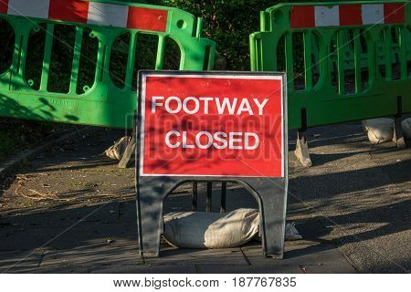 Red sign indicating that the footway is closed