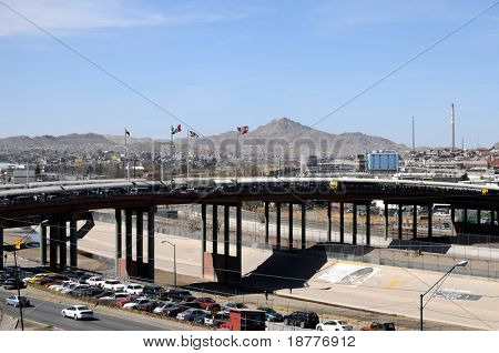 Santa Fe bridge across the Rio Grande (Rio Bravo) river is a major crossing point and smuggling route between El Paso, USA (to the right) and Ciudad Juarez, Mexico (to the left).