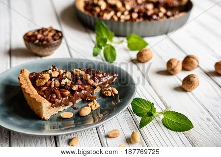 Delicious Chocolate Tart With Walnut, Peanut, Dried Cranberry And Raisins