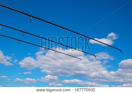 Fishing rods waiting for the background of the beautiful sky
