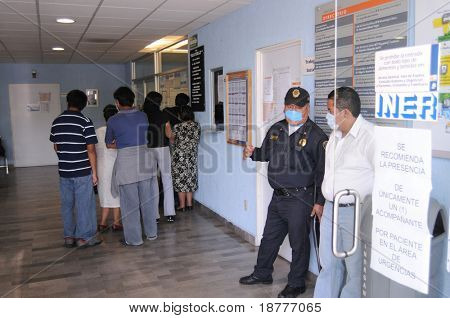 MEXICO CITY - APRIL 28: Patients and visitors line up inside the Mexican Institute of Respiratory Illnesses on April 28, 2009 in Mexico City. Concern over the Swine Flu is spreading worldwide.