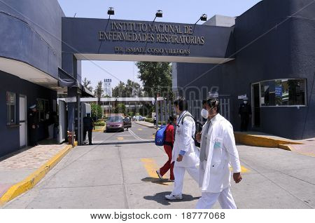 MEXICO CITY - APRIL 28: Hospital workers walk past the main entrance of the Mexican Institute of Respiratory Illnesses on April 28, 2009 in Mexico City. Concern over the Swine Flu spreads worldwide.