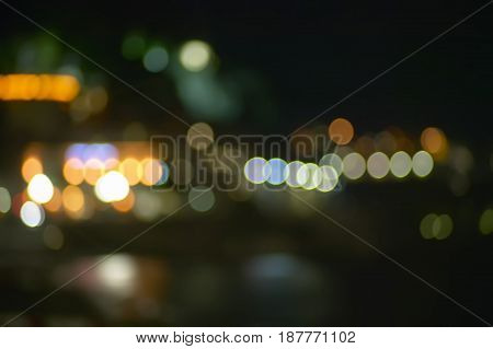 Background with bokeh lights in a city environment. Particularly suitable for graphic projects and backgrounds.