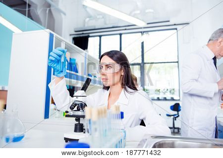 Laboratory, Biotechnology, Experiment. Young Brunette Cute Intern Is Studying New Technology In Scie