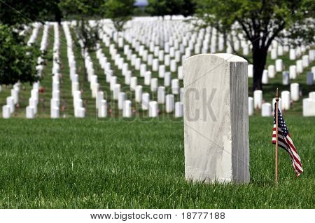 One gravestone with copyspace in front of endless rows of graves at the Arlington National Cemetery in Arlington, Virginia, near Washington DC