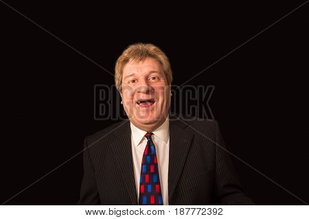 The happy senior businessman laughing on black studio background. Concept of success in business