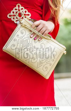 Glamour girl in red dress and Fashionable beautiful big handbag