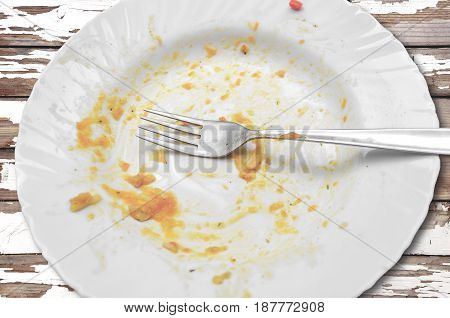 View from above on empty plate dirty after the meal is finished