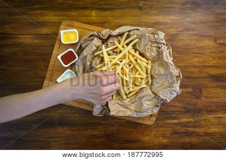 Girl eating fry potatoes in cafe, top view photo