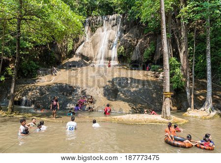 KANCHANABURI THAILAND - MARCH 29: Thai peoples resting at Sai Yok Noi Waterfall in Kanchanaburi on the river Kwai on March 29 2015 in Kanchanaburi Thailand