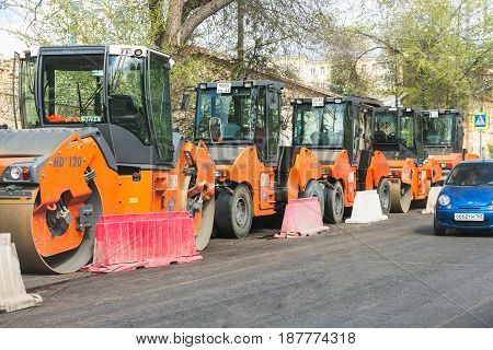 SAMARA, RUSSIA - MAY 14, 2017: A group asphalt compactors is located on Vilonovskaya Street in Samara. Heavy Vibration rollers compactors at asphalt pavement