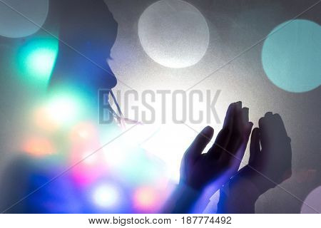 Muslim woman hands up for prying,  colorful  and  vintage tone filter effect color style.