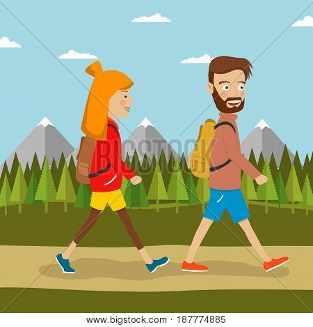 Young couple of hikers with backpacks walking along country road outdoors. Travel, hiking, backpacking, tourism concept