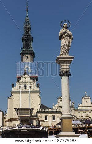 part of the monastery of Jasna Gora in Czestochowa and the statue of Our Lady of the Immaculate Conception in front of the monastery