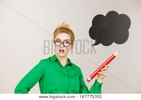 Woman Holding Big Oversized Pencil Thinking