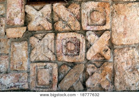 Closeup of a Mayan carving depicting an ancient tic-tac-toe game in Chichen Itza, Mexico