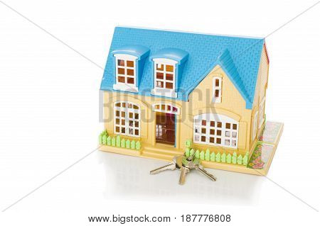 home and house key on a white background
