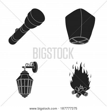 A flashlight, an air lantern, a lantern on the wall, a bonfire.Light source set collection icons in black style vector symbol stock illustration .