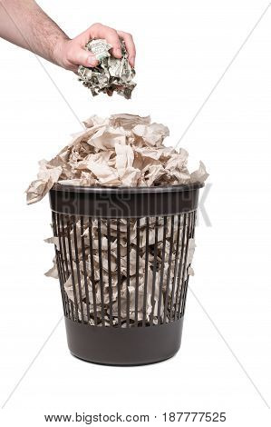 Man hand throws crumpled dollars into a trash can with paper isolated on a white background