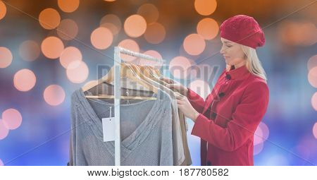 Digital composite of Woman in warm clothes shopping at store