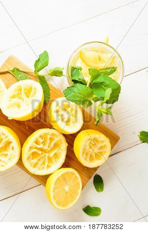 Lemonade With Mint And Squeezed Lemons On Board